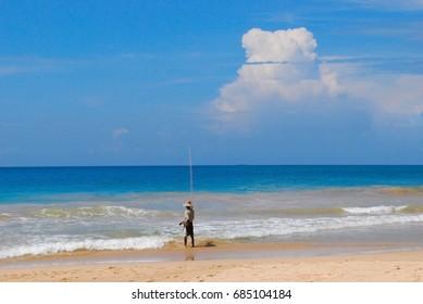 Native fisherman on the beach, Mirissa, Sri Lanka.