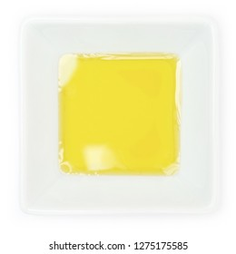 Native olive oil in a white bowl in top view