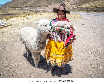 A native Peruvian with her alpaca in Peru.