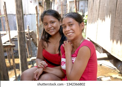 Native Young Girls from Peruvian Amazon Rainforest Living in Wooden Houses, a Traditional Habitation in Rio Negro River. Iquitos, Loreto, Peru, March, 2019