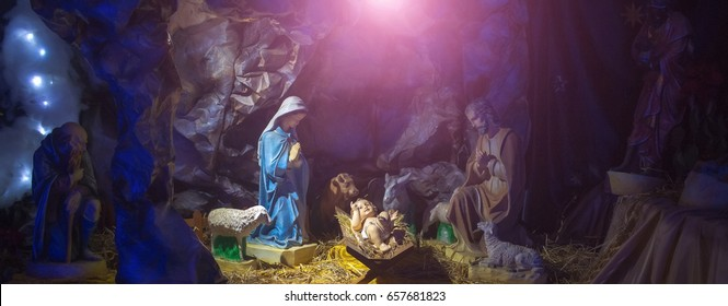 Nativity, manger scene or crib with figurines of infant Jesus, mother Mary, Joseph, sheep and magi in cave. Holy family. Christianity, religion, faith, belief. Christmas, holidays, celebration