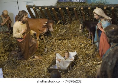Nativity scene of Christ with colored figures in straw