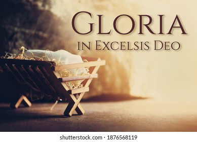 Nativity scene. Christian Christmas concept. Birth of Jesus Christ. Wooden manger in cave background. Banner, copy space. Jesus is reason for season. Salvation, Messiah, Emmanuel, God with us. Gloria.