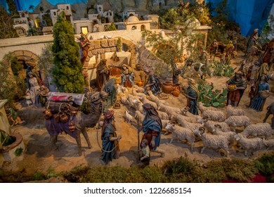 Nativity scene for christmas with small painted poppets, sheep and other animals