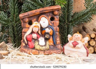 Nativity scene, Holy Family with angel of terracotta. Christmas time decoration