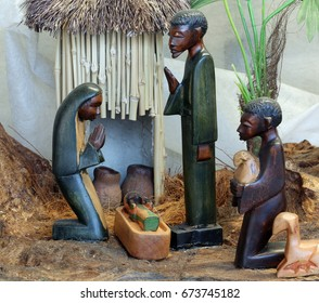Nativity scene with the holy family from Angola in African style with a hut in the background