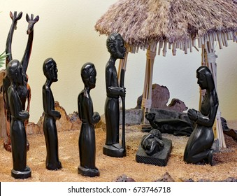 Nativity scene with the holy family, carved on the wooden black Tanzania in African style