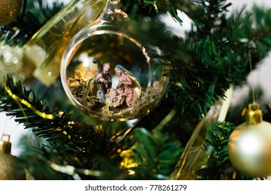 Nativity scene inside a nice ball above the christmas tree