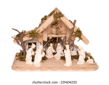 Nativity Scene made of wood and stone, isolated on white