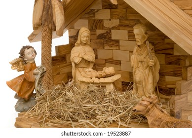 Nativity Scene made of wood, with white background on the left