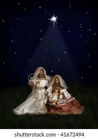 Nativity scene with Mary, Joseph, baby Jesus on dark background with Christmas star