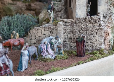 Nativity scene: old man.