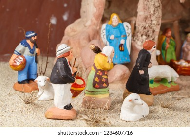 Nativity scene with traditional provencal Christmas crib figures in terracotta