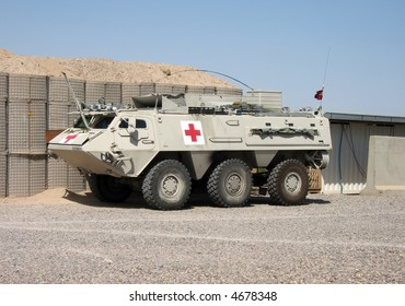 A Nato light armored vehicle with a medical cross on the side