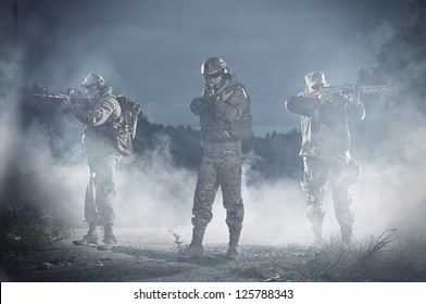 NATO soldiers in full gear. In a defensive posture. Preparing to attack.