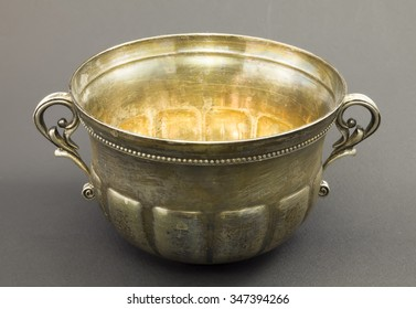 Natural antique old bowl made of silver on a dark background.