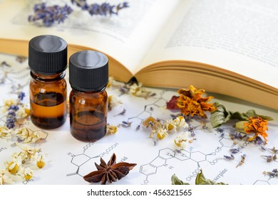 natural apothecary with essential oils and book on science sheet
