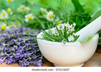 natural apothecary with fresh herbs in mortar