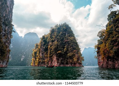 Natural attractions from a long-tailed boat in Ratchaprapha Dam at Khao Sok National Park, Suratthani Province, Thailand.