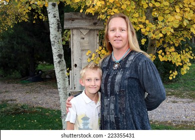 Natural autumn portrait with a mother and son, Utah, USA.