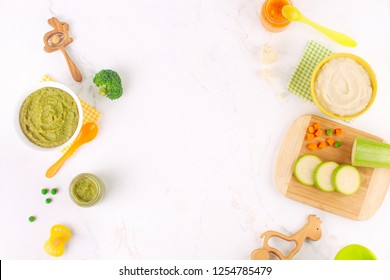 Natural baby food concept. Different types of vegetable puree on the light marble background near ingredients with blank space for text. Top view, flat lay.