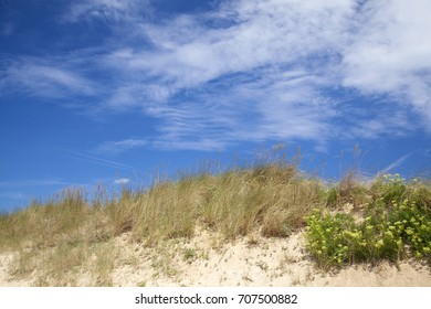 natural background of dunes and blue sky and light clouds