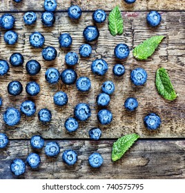 Natural background. Food background. Blueberries ripe and tasty on a wooden table. A large plan, a top view,