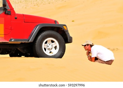 Natural background: jeep in the sand desert.