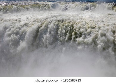 Natural background. Power in water. Closeup view of the famous Niagara falls in Canada. The mist and falling white water beautiful texture, motion and pattern.
