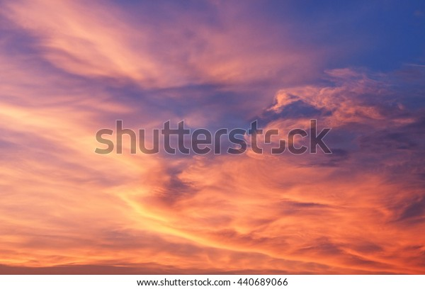 Natural background. The sky at sunset, flaring all shades of the red.