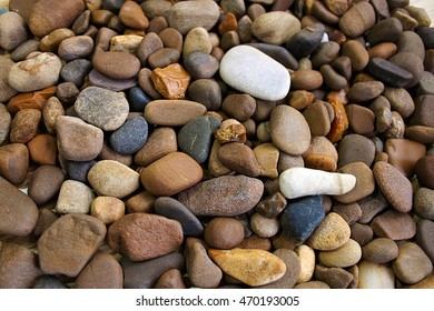Natural background texture of colorful sea stones.