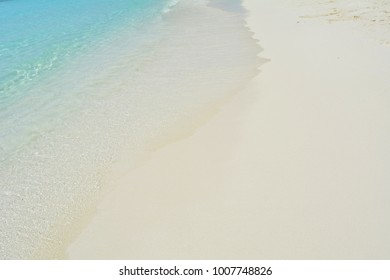 Natural background with turquoise water and light sand at the beach