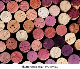 Natural background of wooden plugs in different shades and colors. Top view of bottle caps with red and white wine. Top view on wine cork.
