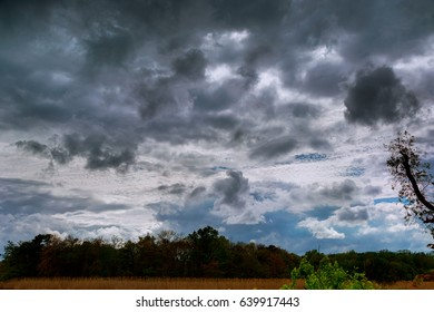 Natural backgrounds: stormy sky Thundercloud with possible formation of a tornado with a slight
