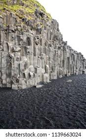 Natural basalt stone columns and black sand beach, Reynisfjara, Iceland