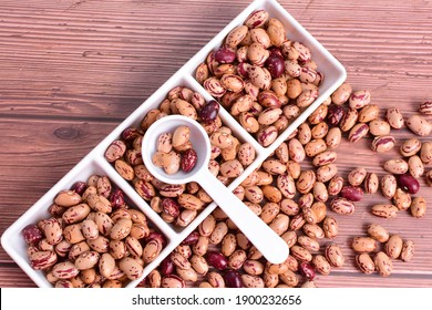Natural bean grains, Phaseolus vulgaris on wooden background with dark veins
