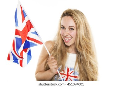 Natural beautiful blonde young woman supporter laughing holding a United Kingdom union jack stock photography