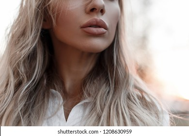 Natural beautiful female lips outdoor.  Close-up. Woman in autumn day
