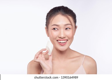 natural beautiful woman with powder puff on white background