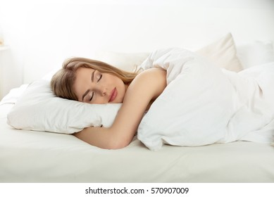 Natural beautiful woman sleeping in the bed.
