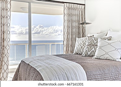 Natural beauty close to bed and window, comfortable beds including designs, walls are white color, small pillow is beautiful, inside rooms of a apartment.