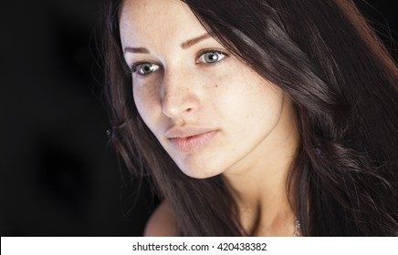 Natural beauty, girl with freckles and pimples