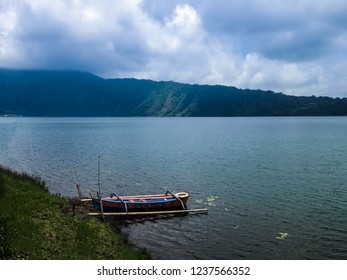 Natural Beauty Of Mountains Lake Beratan And The Canoe At Bedugul, Tabanan, Bali, Indonesia