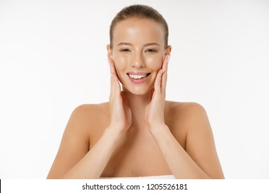 Natural Beauty Portrait. Beautiful Spa Woman smiling isolated over white background. Perfect Fresh Nude Skin