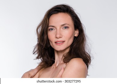 Natural beauty portrait of middle aged woman with disheveled hair, sensual, attra