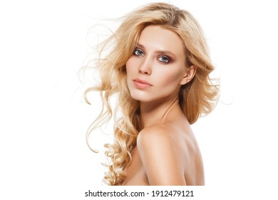 Natural beauty and skincare concept. Portrait of beautiful female model with clean face isolated on white background. Young woman shows healthy sensitive skin after using cosmetics and makeup.