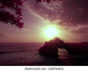 Natural Beauty of Sunset View Batu Bolong Temple At Tanah Lot Area, Tabanan, Bali, Indonesia