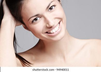 natural beauty woman with big beautiful smile, studio shot