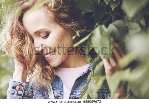 Natural beauty of women between leaves