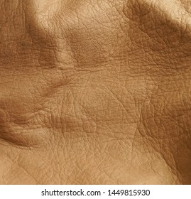 Natural beige leather texture background close up full frame